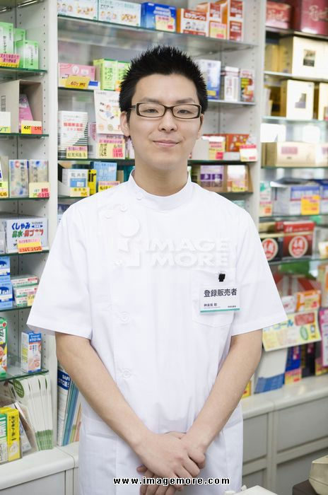 Registered Vendor of Drugstore Standing in Front of Shelves