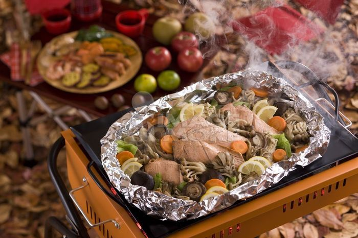 Foil-baked Salmon Cooked on Barbecue Grill in Autumn