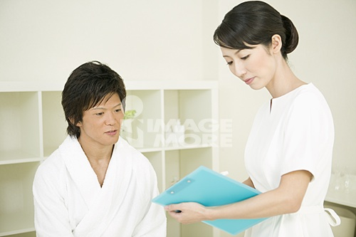 Massage therapist counseling man