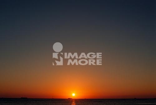 Sun setting on beach