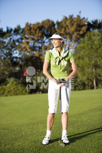 Woman standing on a golf course