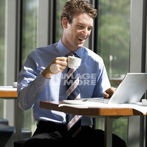 A businessman working on a laptop computer