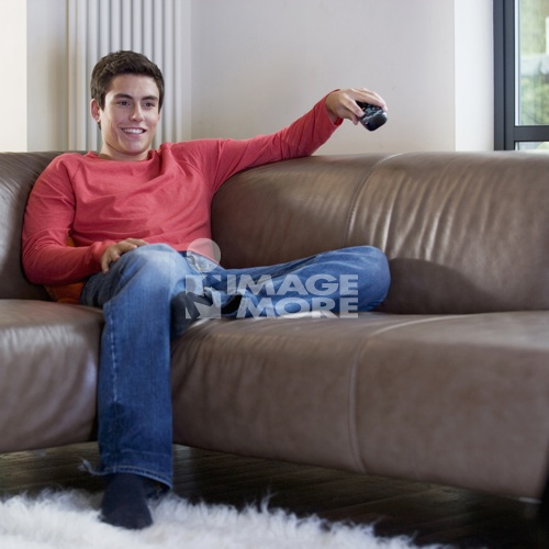 A teenage boy watching television