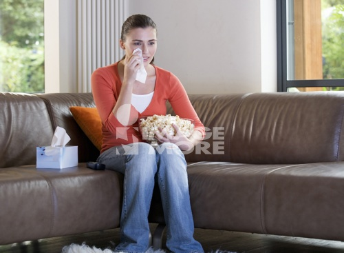 A teenage girl watching television