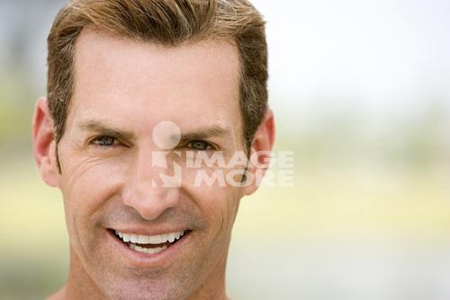 portrait mid adult man with stubble