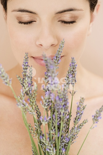 Young woman smelling lavender flowers