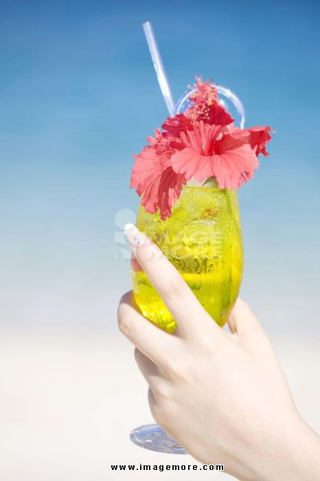 Female hand with a tropical juice