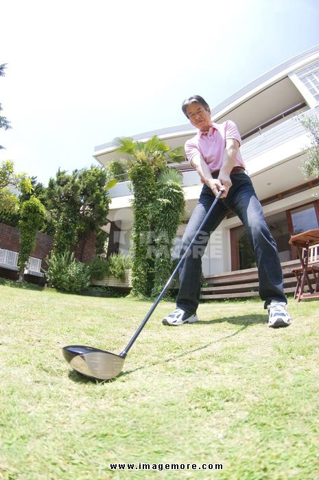 Senior men to practice golf in the garden