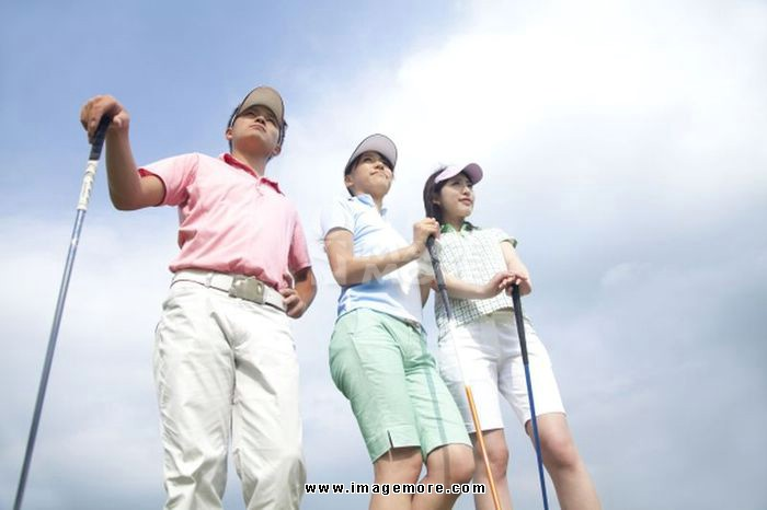 Men and women look up at the sky with a golf club