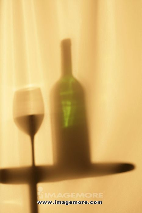 Shadows of Wine Bottles and Glasses of Wine,