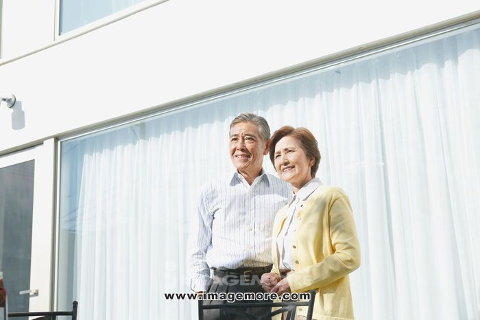 Senior Japanese couple in the garden,
