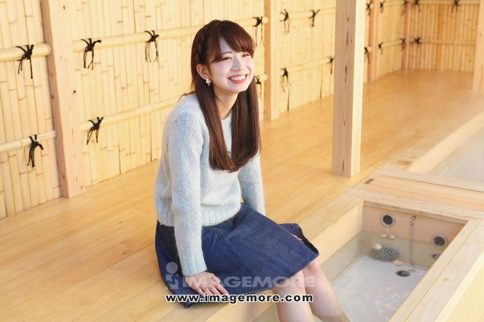 Young Japanese woman enjoying foot spa in Kawagoe, Japan,