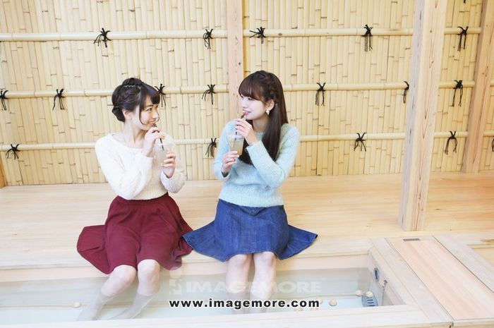 Young Japanese women enjoying foot spa in Kawagoe, Japan,