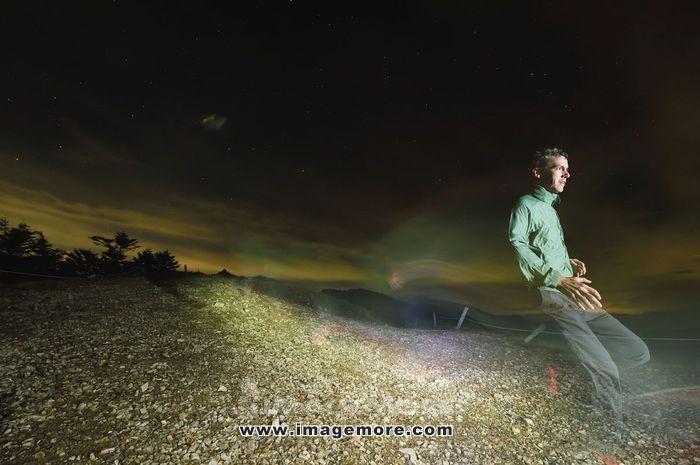 Caucasian man running at night at Mount Daibosatsu, Yamanashi Prefecture, Japan,