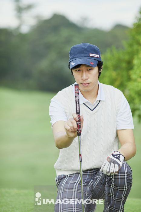 Japanese golf player on course,