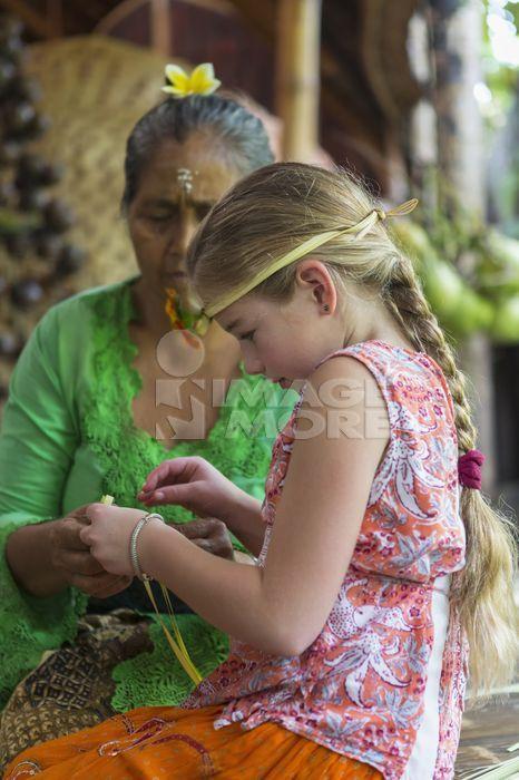 Girl learning Balinese weaving, Ubud, Bali, Indonesia