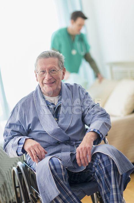 Senior Caucasian man smiling in wheelchair