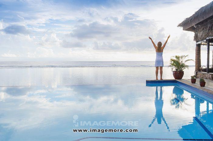 Caucasian woman cheering near swimming pool