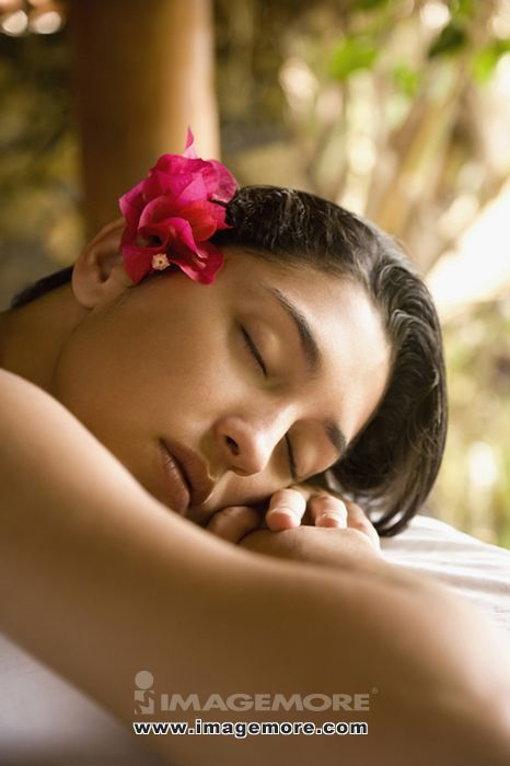 Close up of Pacific Islander woman sleeping on massage table