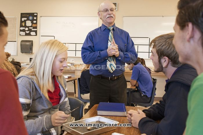 Teacher talking to students in science class