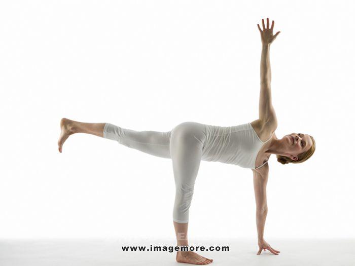Caucasian woman practicing yoga,