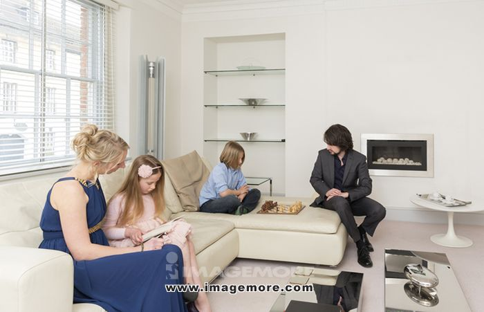 Caucasian family relaxing in living room,