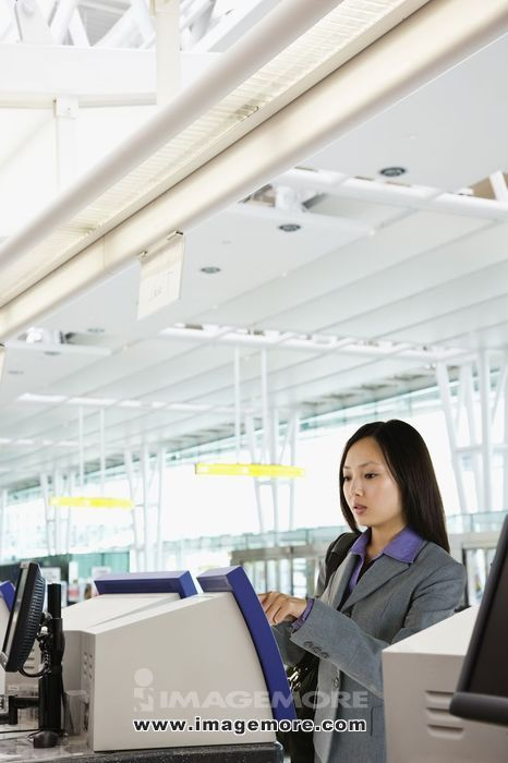Asian businesswoman checking in at airport