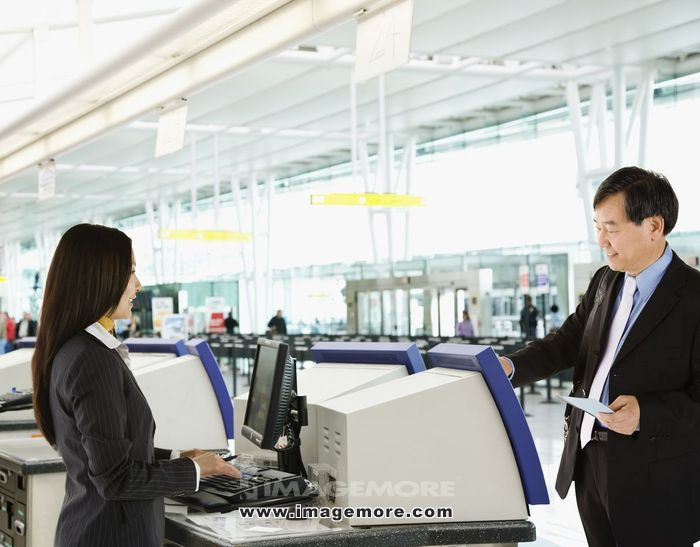 Asian businessman checking in at airport