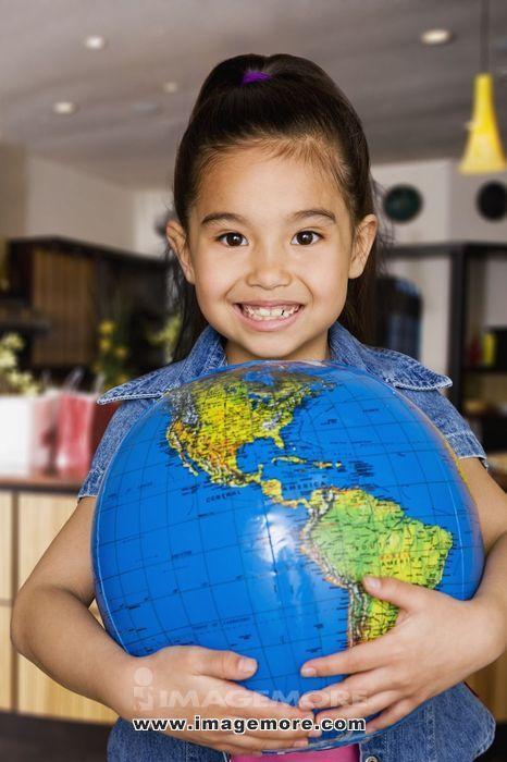 Chinese girl holding globe