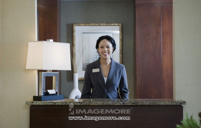 African woman at concierge desk
