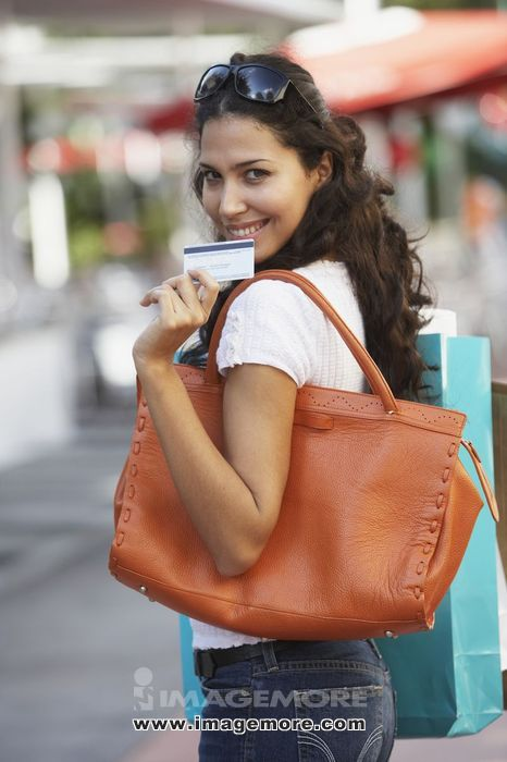 Hispanic woman holding credit card