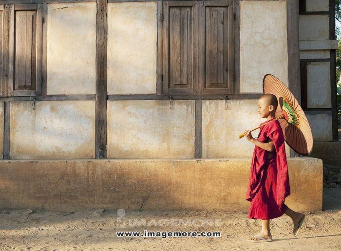 asianboynation_asian boy walking down street with sun umbrella