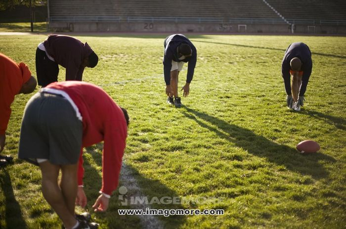 Men training on football field