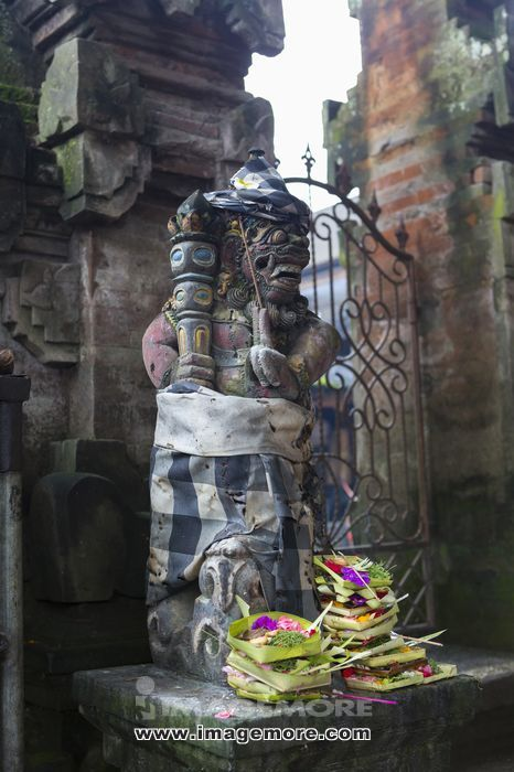 Offerings at base of Hindu statue, Ubud, Bali, Indonesia