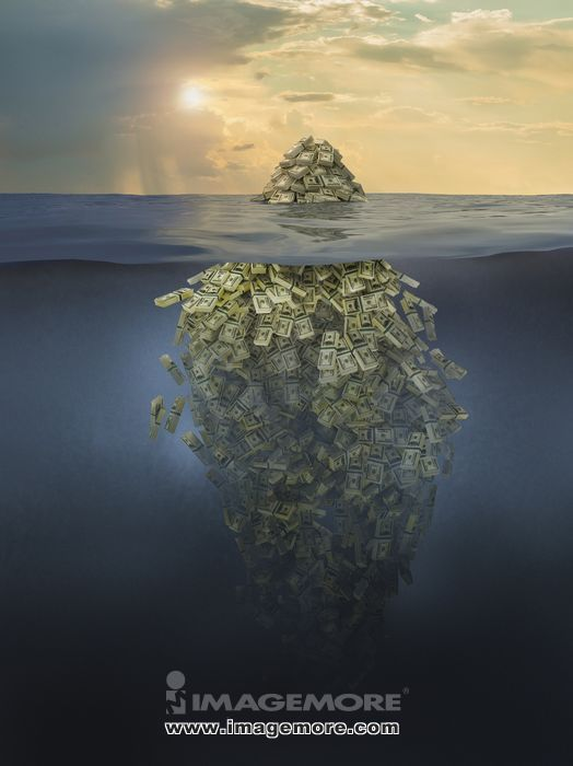 Iceberg of money floating in ocean