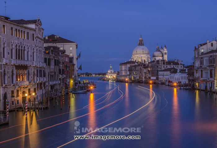 Time lapse view of gondolas on urban canal at night, Venice, Veneto, Italy