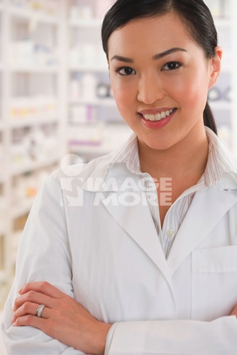 Asian female pharmacist standing in pharmacy