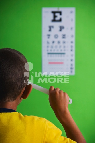 African boy taking eye exam
