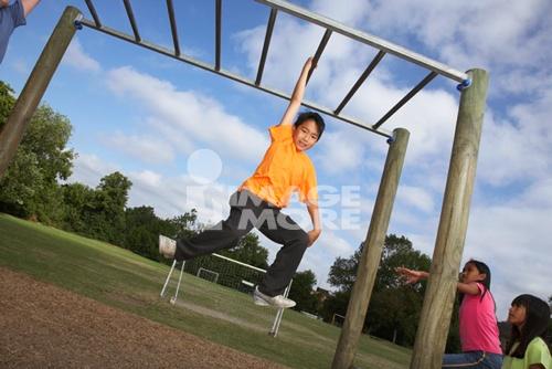 asianboynation_asian boy hanging on jungle gym