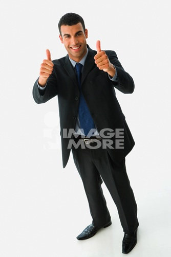 http://thumbs.dreamstime.com/z/photomodel-22603086.jpg_hispanic businessman giving thumbs up