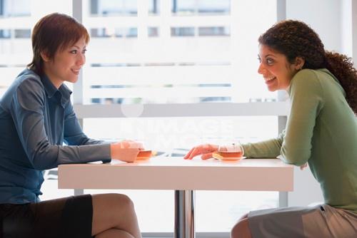 Multi-ethnic businesswomen at cafe