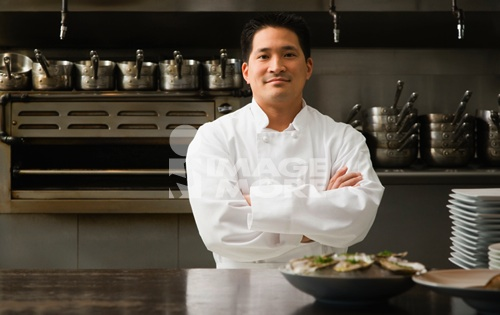 Asian male chef with arms crossed