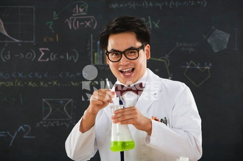 Nerdy Asian male student in science class