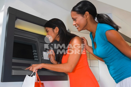 Hispanic women using atm