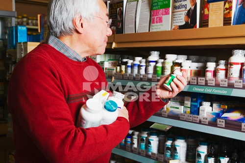 Senior Asian man shopping for natural medicine
