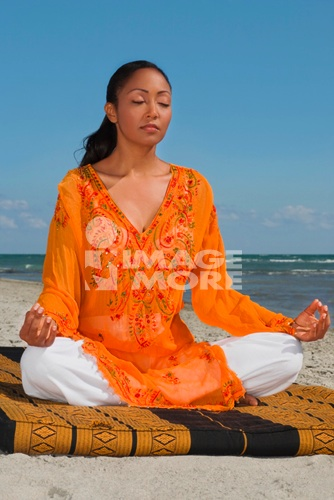 Hispanic woman meditating