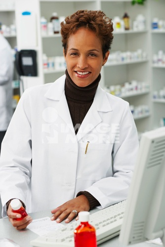 Portrait of African female pharmacist in pharmacy