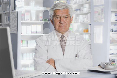 Hispanic pharmacist in drug store