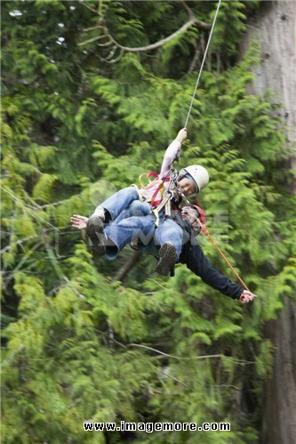 Father and daughter rappelling together