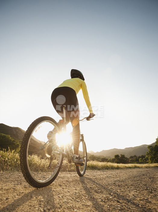 Mixed race woman riding on mountain bike